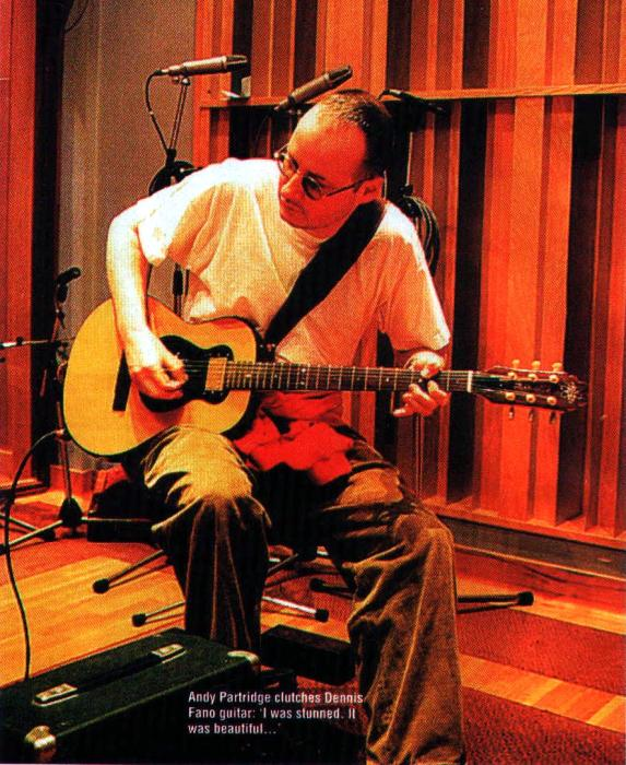 Andy Partridge clutches Dennis Fano guitar